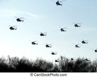 helicopters - Helicopters on a background of the blue sky