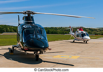 Helicopters on an airfield - Two helicopters on  on airfield