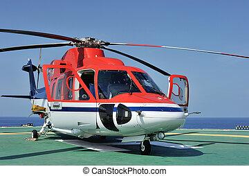 helikopter, voor de kust