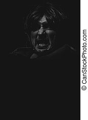 Hell, vampire man with great contrasts of light, large black cloak
