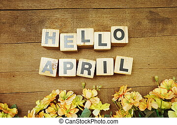 Hello April alphabet letters on wooden background