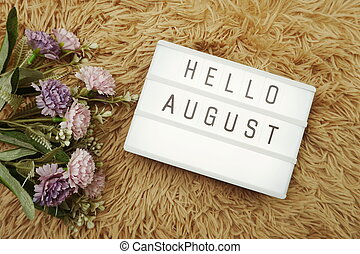 Hello August word in light box and flower bouquet
