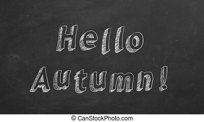 """Hand drawing and animated text """"Hello Autumn !"""" on blackboard. Stop motion animation."""