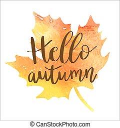 Hello autumn hand lettering phrase on orange watercolor maple leaf background.