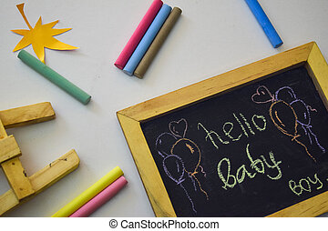Hello baby on the blackboard isolated white background