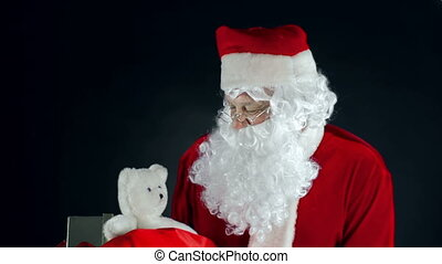 Hello, Christmas - Portrait of Santa Claus standing against...
