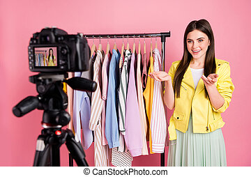 Hello dear subscribers. Photo of pretty lady broadcasting online blog new collection store feedback wear trend yellow leather jacket green skirt isolated pastel pink color background