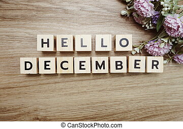 Hello December alphabet letters on wooden background