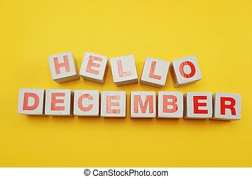 Hello December alphabet letters on yellow background