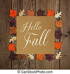 Hello Fall greeting card with frame of wooden autumn leaves