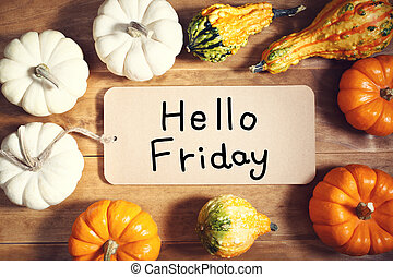 Hello Friday message with colorful pumpkins and squashes