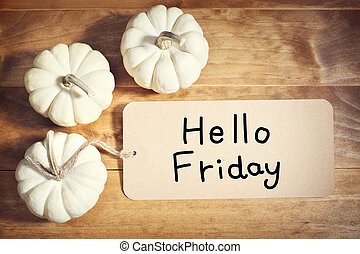Hello Friday message with small white pumpkins