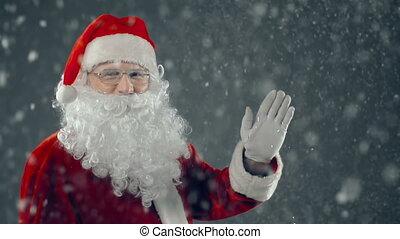 Hello, Kids - Close up of Santa waving and looking at...