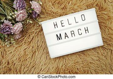 Hello March word in light box and flower bouquet