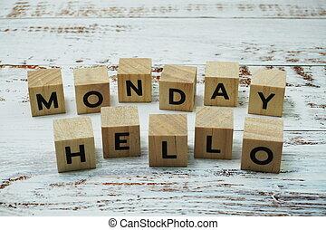 Hello Monday alphabet letter on wooden background