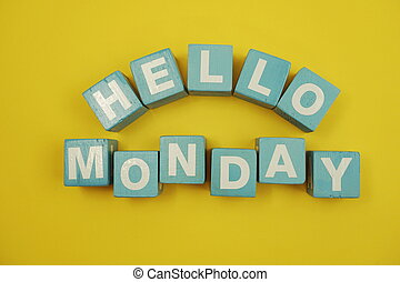Hello Monday alphabet letters on yellow background