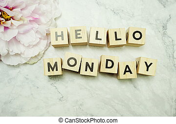Hello Monday wooden letter alphabet on marble background