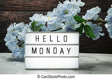 Hello Monday word in light box with Flowers Decoration