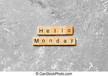 hello monday word written on wood block. hello monday text on cement table for your desing, concept