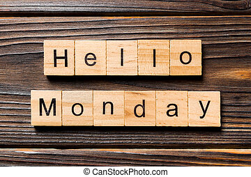 hello Monday word written on wood block. hello Monday text on wooden table for your desing, concept