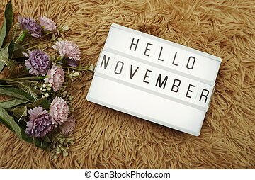 Hello November word in light box and flower bouquet