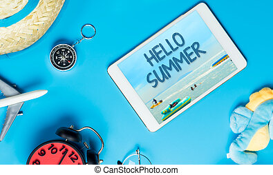 Hello Summer poster on tablet with summer travel accessories