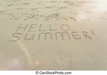Hello summer written on the beach