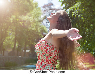 Hello Sun! - young cute woman enjoys the sun and nature {...