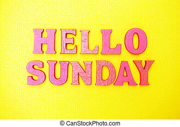 Hello Sunday alphabet letters on yellow background