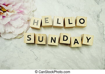 Hello Sunday word on light box with space copy on marble background