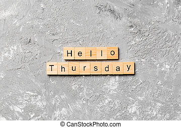 hello thursday word written on wood block. hello thursday text on cement table for your desing, concept