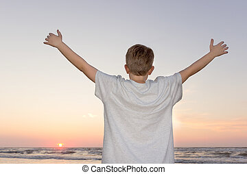 Hello to the sun - A young boy happily greets the sund and...