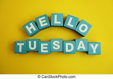 Hello Tuesday alphabet letters on yellow background