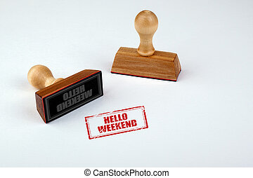 Hello Weekend. Rubber Stamper with Wooden handle Isolated on White Background