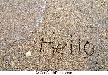 Hello word written on the sandy beach