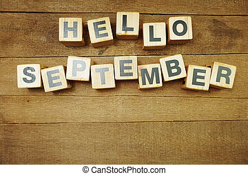 Hellow September alphabet letters on wooden background