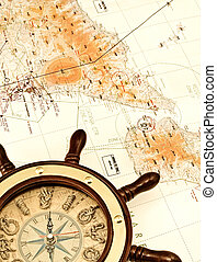 Helm on the map - conceptual image of travel, exploration or...