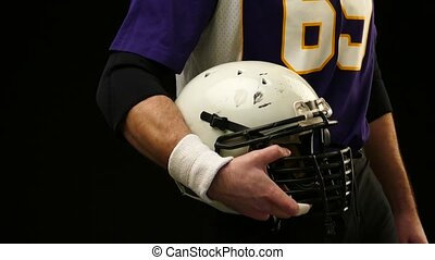 Head protection helmet hold American Football Player