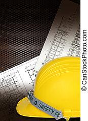 Helmet of constructor with blueprints building construction