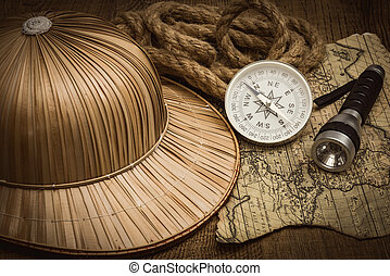 helmet on the background of an old colonial map with a compass