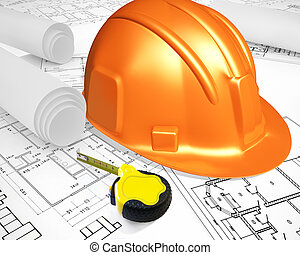 Helmet with ruler placed on blueprint of house
