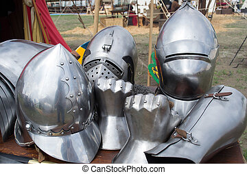 helmets and pieces of medieval armor