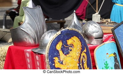 Helmets and Shields - Medieval helmets and shields shining...
