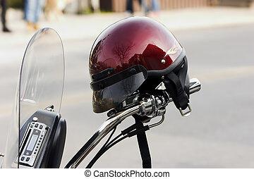 Helmut on handlebars - Red helmut propped on the handlebars...
