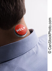 Help! Close-up rear view of men with a help button on his...