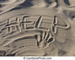 help me - sign help written on sand and a handprint