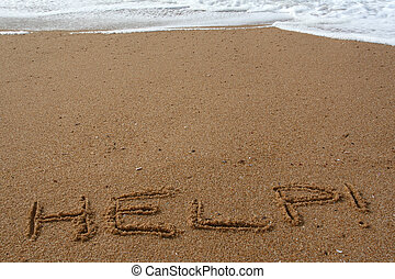 Help - Word help spelled in the sand on a beach
