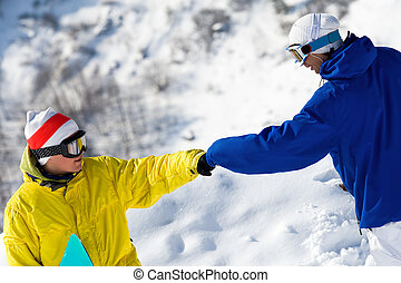 Help - Portrait of two guys with snowboards climbing down...