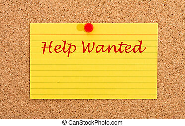 Help Wanted - A yellow index card on a cork board with the...