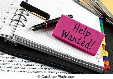 Help Wanted note on agenda and pen